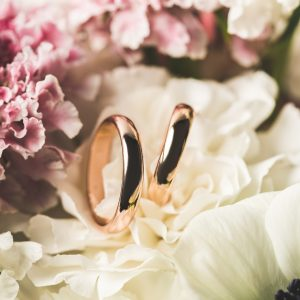 close-up-view-of-wedding-rings-in-bridal-bouquet-M8VNF78.jpg